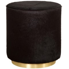 Modern Style Round Chubby Ottoman in Black Cowhide with Polished Brass Toe Kick