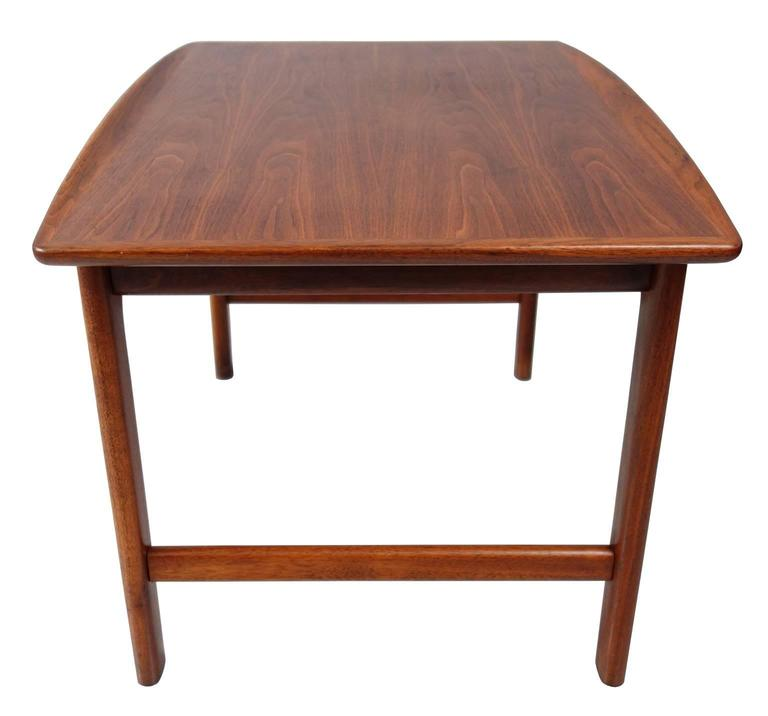 Handsome end or side table with raised edges. By Folke Ohlsson for DUX , the Frisco line. Can also serve as a coffee table. In excellent condition.