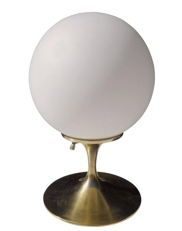 Wonderful Laurel lamp designed by Bill Curry. Featuring a white frosted glass globe on a brass tulip base.