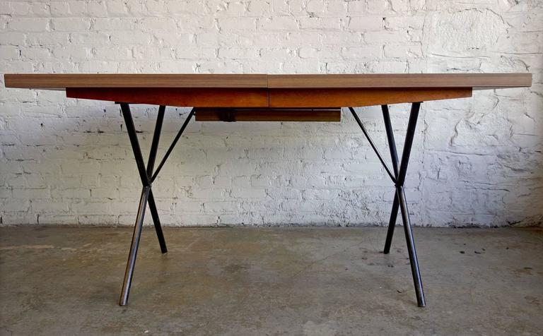 """Early Mid-Century George Nelson for Herman Miller X-leg dining table. Perfect patina on this dining or kitchen table that can be extended from 54"""" to 90"""" by internal leaves that fold up. Can also be used as a desk. Early example with"""