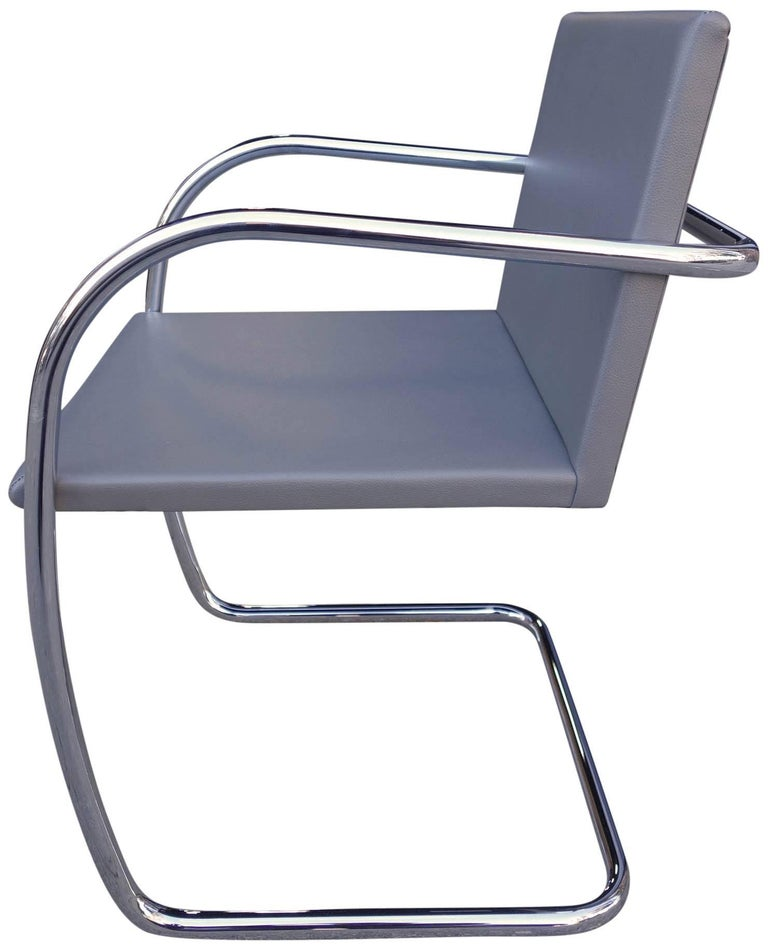 Up to three midcentury Brno chairs in gray leather on a polished stainless steel frame. Produced by Knoll. Each one has never been used and in excellent condition. This is the Thin-seat version, modeled after the original 1929 specifications.