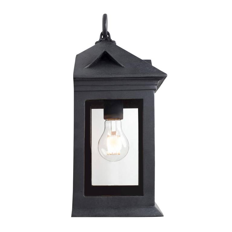 This lantern's balanced proportions perfectly blend the Spanish Colonial Revival and Craftsman movements, both popular in the early 1900s. Simple yet elegant, this lantern embodies the sturdy structuring of the Craftsman cottage, mimicking the