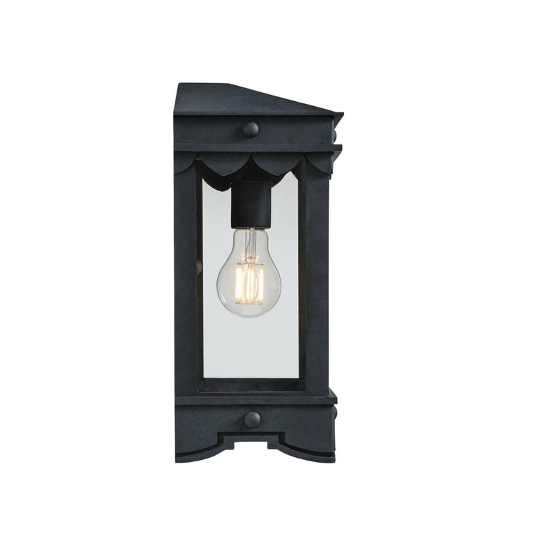 This lantern has Mediterranean style precedence with historic profiles and contemporized geometric lines. A striking fixture during the day but even more so at night when the patterned hem casts intricate shadows.  Lantern shown in SBLC Grey Finish