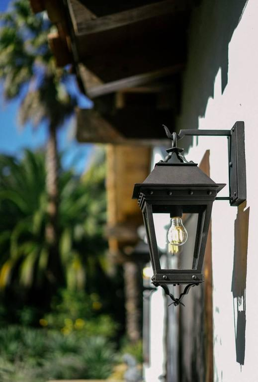 New Spanish Wrought Iron Exterior Arm Mount Wall Lantern by Britt Jewett In New Condition For Sale In Santa Barbara, CA