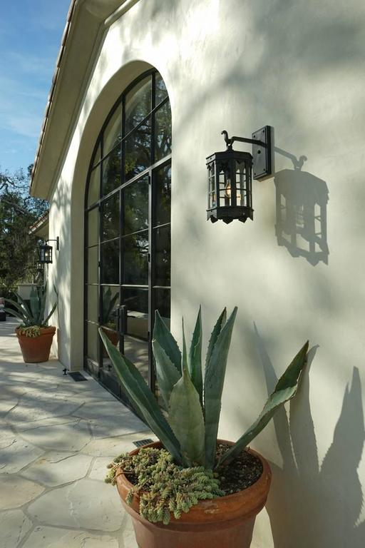 American Detailed Spanish Wrought Iron Exterior Outdoor Arm Mount Lantern by Britt Jewett For Sale