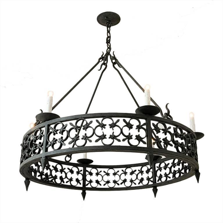Large round wrought iron chandelier with modified fleur de lis large round wrought iron chandelier with modified fleur de lis pattern detailing for sale aloadofball