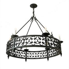Large Round Wrought Iron Chandelier with Modified Fleur-de-Lis Pattern Detailing