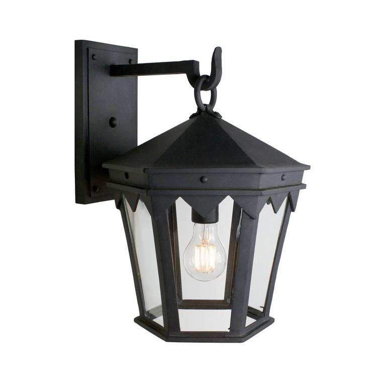 Designed to pair with the historic Oreña Adobe in Santa Barbara, a Spanish influenced top cresting, sharp geometries and six-sided tapered shape.   All lanterns go through a metalizing process, a protective zinc layer added to ensure protection and