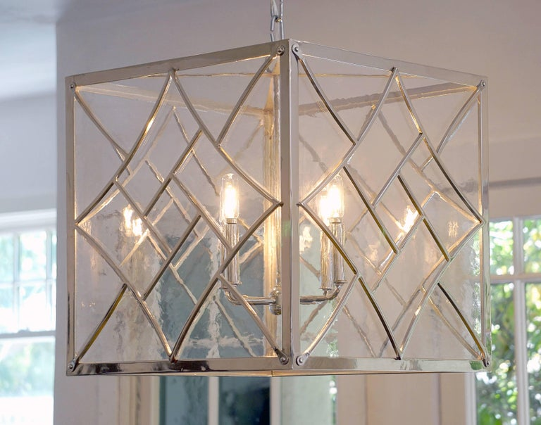 Evoking the Art Deco style of the 1920s and 1930s, our Nouveau pendant features bold geometric shapes and a chevron motif. Handcrafted in wrought iron with a polished nickel finish. Antique style glass pairs well with the Art Deco design, providing