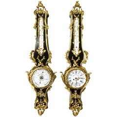 Pair of French 19th Century Louis XV Style Ebonized Cartel Clock and Barometer