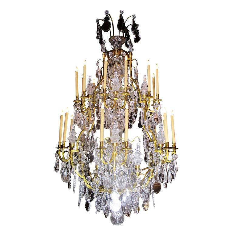 A Louis XV Style Gilt-Bronze and Cut-Glass Twenty-four-light Chandelier