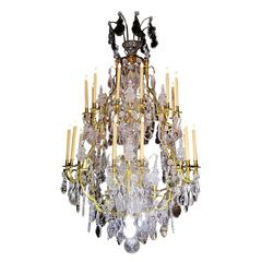 A Louis XV Style Gilt-Bronze and Cut-Glass Twenty-four-light Chandelier