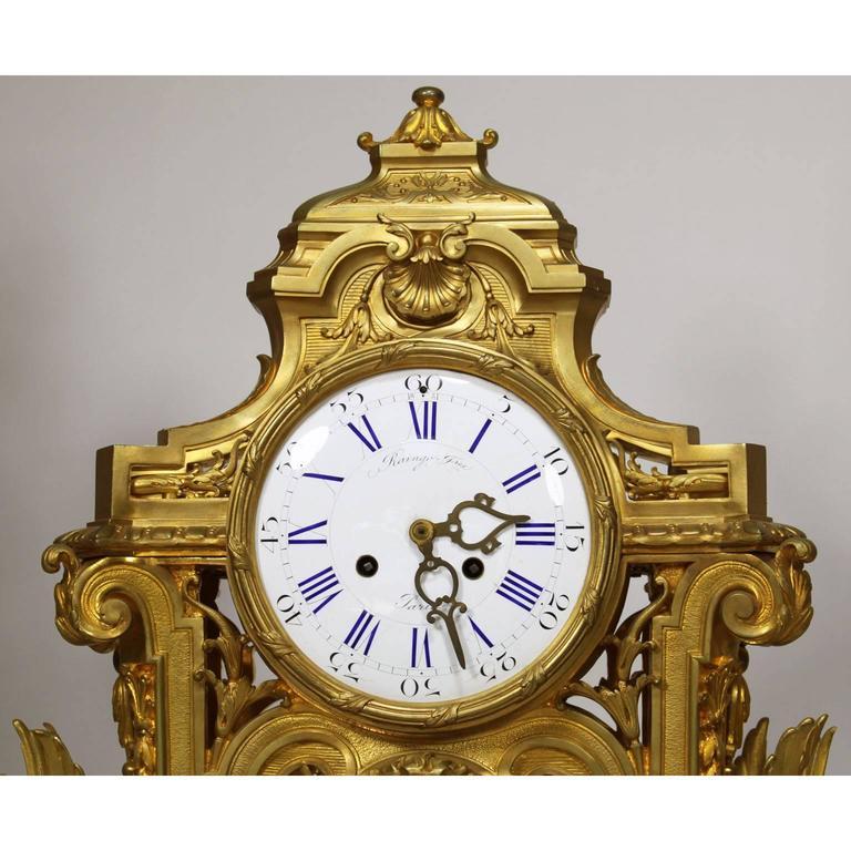 Gilt French 19th Century Louis XIV Style Figural Ormolu Clock Garniture, Raingo Frers For Sale