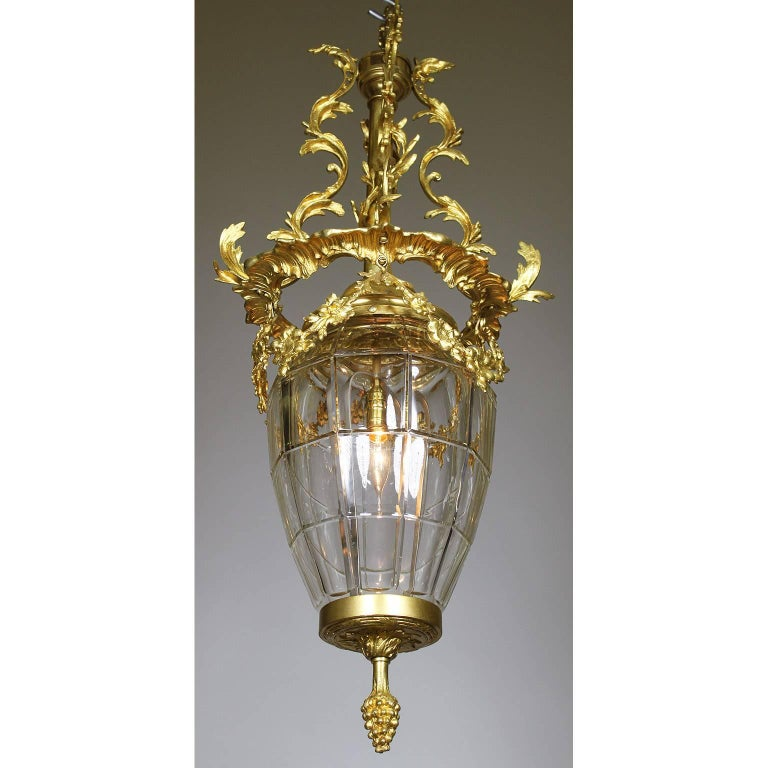 An ornate French 19th-20th century gilt bronze and gilt-metal molded glass
