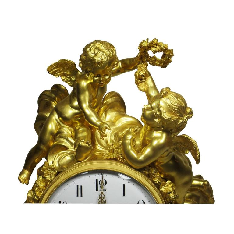 A very fine and important palatial Louis XV style 19th-20th century figural gilt bronze white marble mantel clock with figures of cherubs, the enamel dial with Arabic numerals and foliate pierced gilt hands. in the style of Alfred-Emmanuel-Louis