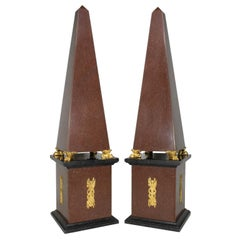 A Pair of French Empire 19th-20th Century Red Porphyry and Gilt-Bronze Obelisks