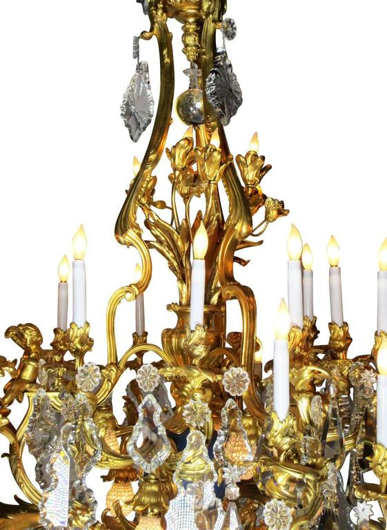 Carved French 19th Century Louis XV Style Cherub & Dragons Ormolu & Crystal Chandelier For Sale