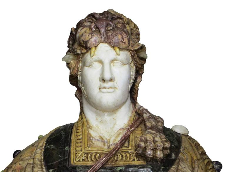 A very fine and lifesize Italian, early 20th century specimen marble bust of a Greco Roman Warrior, probably Hercules, after the antique. The beautifully carved and impressive bust depicted with a white marble head posing with a direct gaze, his