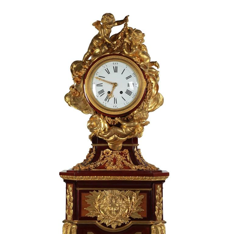 A very fine French 19th Century Louis XVI style ormolu-mounted amaranth, tulipwood, sycamore and parquetry pedestal Régulateur de Parquet Tall Case Clock, Attributed to Alfred Emmanuel Louis Beurdeley (French, 1847-1919) After the model attributed