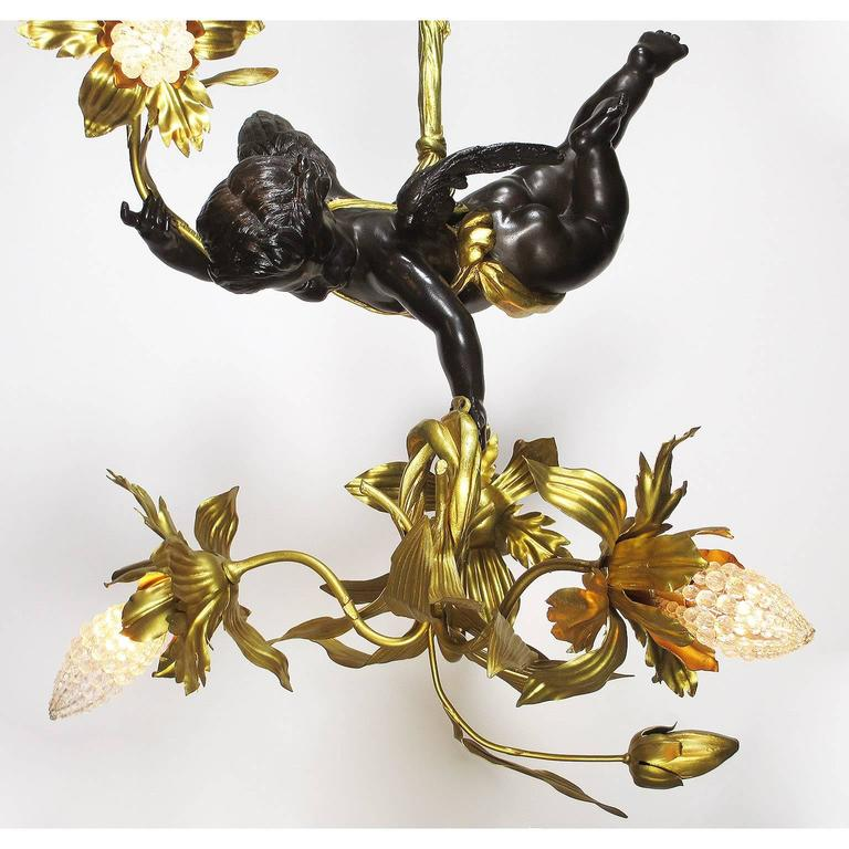 Belle Époque Fine French Belle Epoque Patinated and Gilt Bronze Hovering Cherub Chandelier For Sale