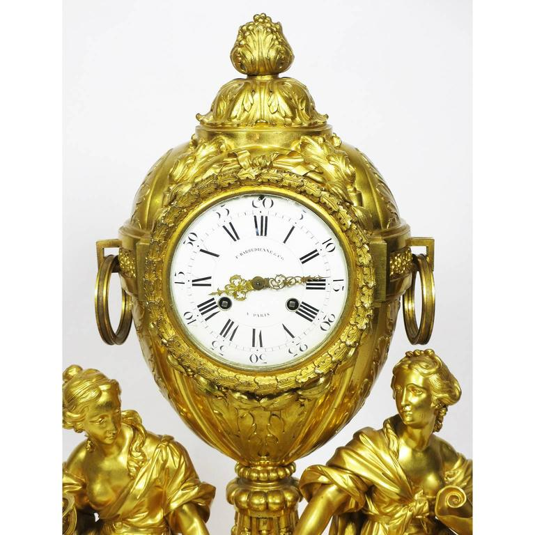 A very fine French 19th century Louis XVI style gilt bronze figural mantel clock, Hologe à Poser, by Fedinand Barbedienne, the enamel dial signed F. Barbédienne & Cie. / A Paris, the twin train movement stamped with the Vicenti pastille and