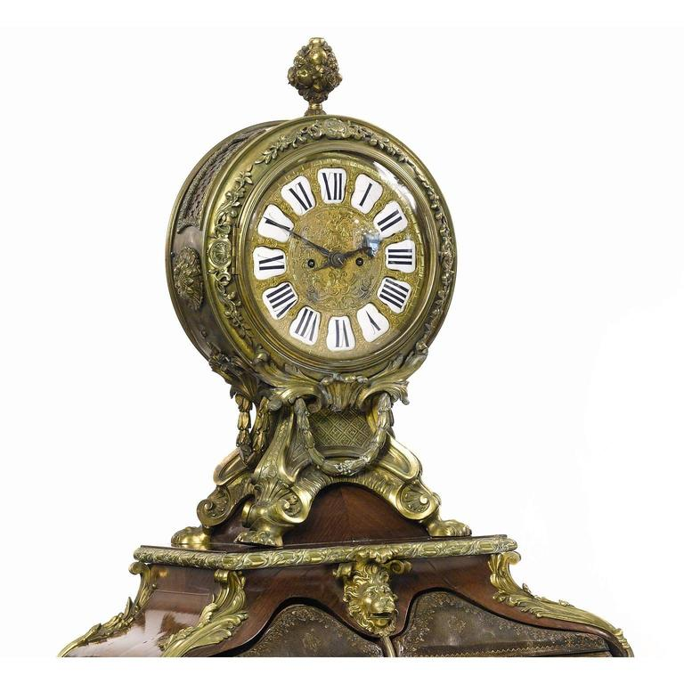A very fine and palatial French 19th century Louis XV style gilt bronze mounted, leather, tulipwood and kingwood parquetry cartonnier with clock. The circular clock with elaborate pierced case with reticulated panels backed with silk lining, floral