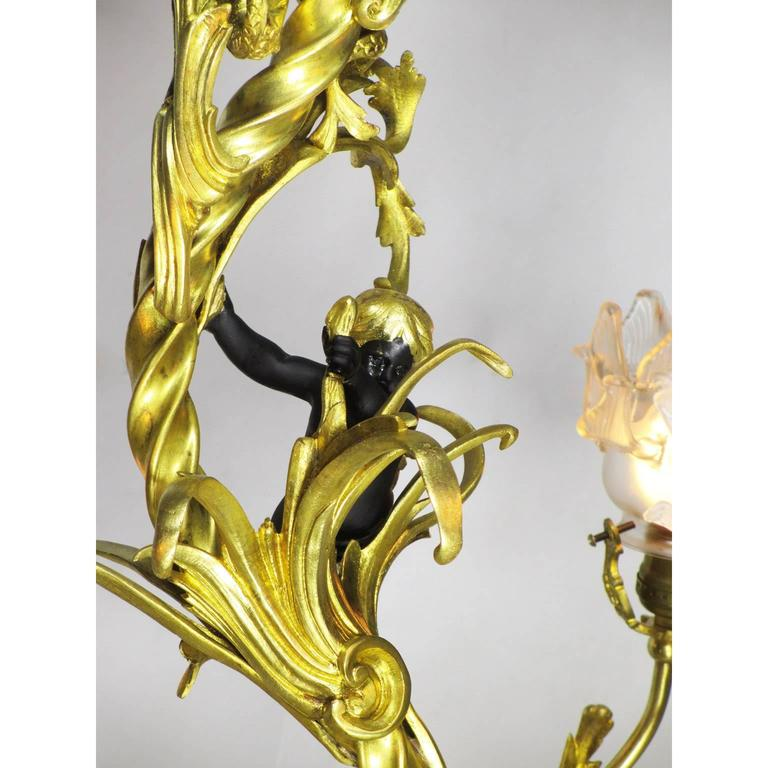 Early 20th Century French Belle Époque Gilt Bronze Four-Light Whimsical Chandelier For Sale
