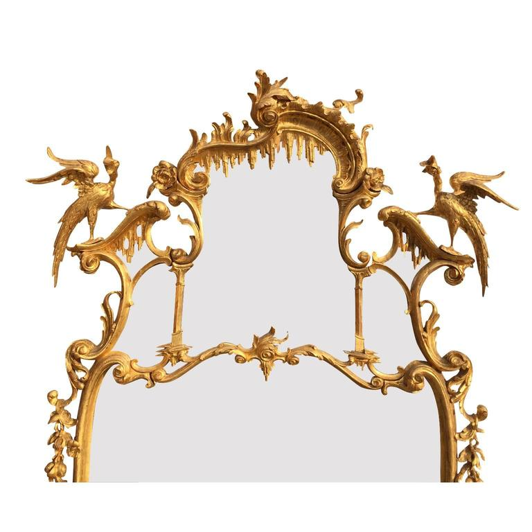 A very fine and Impressive English Rococo 19th century Chippendale style Figural gilt wood carved Over mantel or Pier mirror in the manner of Thomas Johnson after his Collection of Designs, 1758. The sectional divided ornately carved gilt wood frame