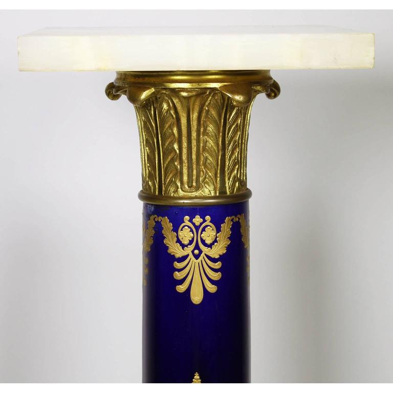 A fine French Empire Napoleon III probably sevres porcelain gilt bronze mounted and onyx pedestal stand with fine 24-carat gild decorated with wreaths around the letter