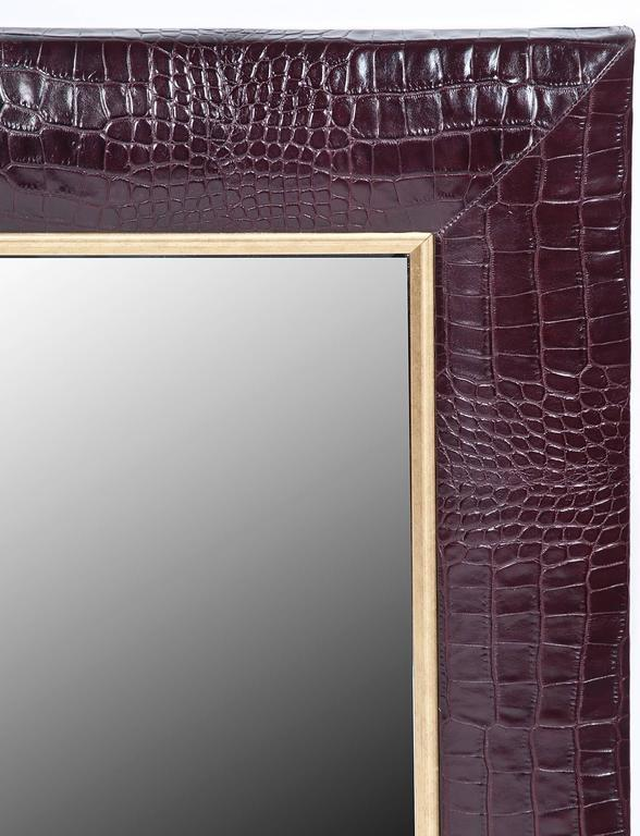 """• Crocodile Embossed Bordeaux Italian Leather with champagne gold detailing • 1 ¼"""" Beveled Mirror • 4"""" wide leather frame • Hand-stitched corners • Measurements including frame – 28""""W x 32""""H x 1""""D  Additional quantity made to order upon"""
