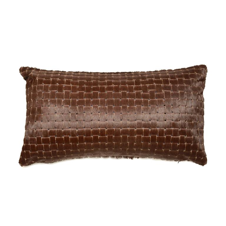 Chocolate brown laser cut cowhide hair lumbar pillows.  Luxurious high sheen cowhide from Normandy, France. Chocolate brown with navy lining visible through sure laser cuts. Basket weave laser cut pattern. 12