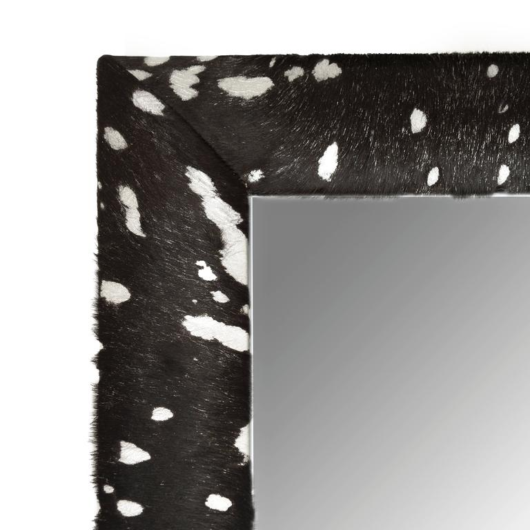 """Contemporary black cowhide hair with silver metallic acid wash splash framed beveled mirror by KLASP home.  Made by skilled professional craftsmen. 1 ¼"""" beveled mirror. 4"""" wide leather frame. Hand-stitched corners. Measurements including frame"""
