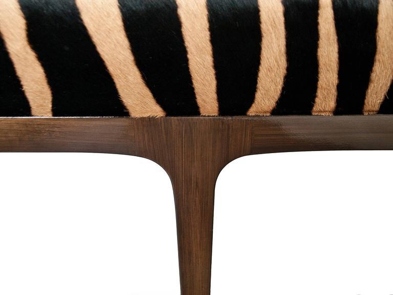 KLASP home Mid-Century Modern style zebra stencil printed cowhide bench.  Zebra stencil printed cowhide 7 foot bench Normandy cowhide Mid-Century Modern style frame 90 shine Walnut frame Measures: 7' L x 16.5