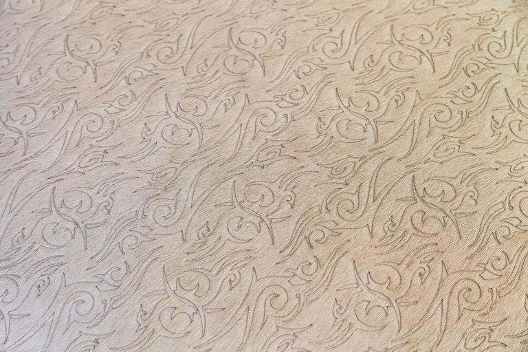 American Pair of Mid-Century Modern Style Laser Cut Floral Pattern Cowhide Ottomans For Sale