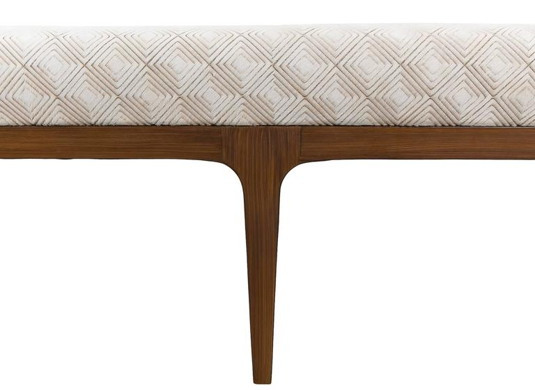 Mid-Century Modern style bench with a diamond laser cut pattern cowhide upholstered cushion seat in natural ivory.  Diamond laser cut cowhide. Seamless 7 foot bench. Normandy cowhide. Mid-Century Modern style frame. 90 shine. Dark brown