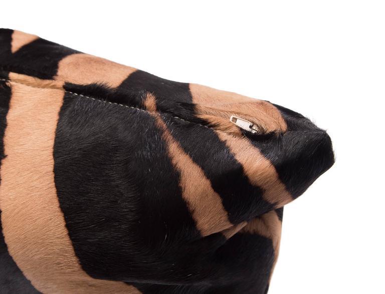 Contemporary zebra stencil cowhide hair pillows.  Luxurious high sheen cowhide from Normandy France. Zebra pattern. Hidden zipper. Measures: 12
