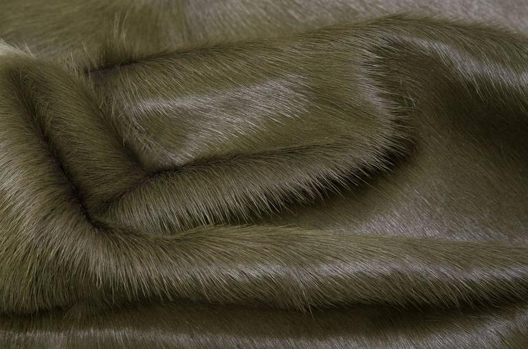 Military green cowhide rug all of our hair cow hides are full hides and measure approximately 7' W x 8' L. They are of the highest quality from the French region of Normandy and naturally raised in a free roaming field. The hair of these cows is