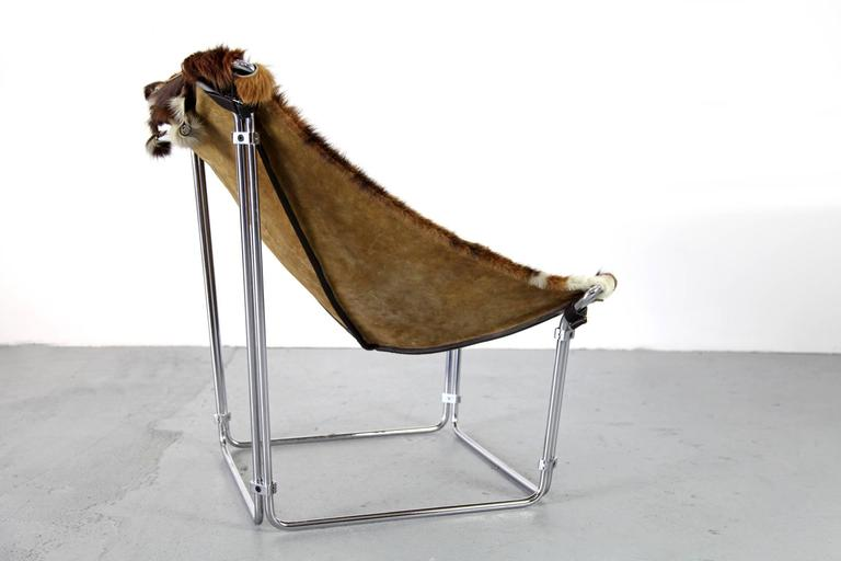 Mid-Century Modern Cowhide Lounge Chair with Ottoman by Kwok Hoi Chan Produced by Steiner, Paris For Sale