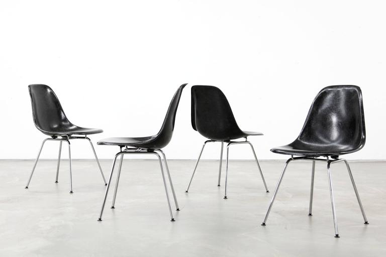 Set Of Four Black Side Chairs By Charles And Ray Eames. The Chairs Have Been
