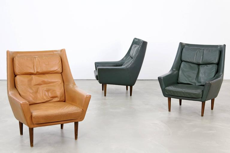 Beautiful set of two leather lounge chairs from the 1960s. These chairs were produced in Denmark, the design is attributed to Hans Olsen. The chairs are upholstered in dark green original leather and are in beautifully patinated condition.