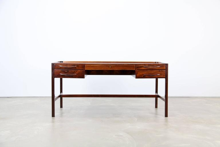 Sophisticated desk with beautifully sculpted details, designed 1957 by Kurt Østervig. This desk features finest craftsmanship and materials. It is in excellent condition.