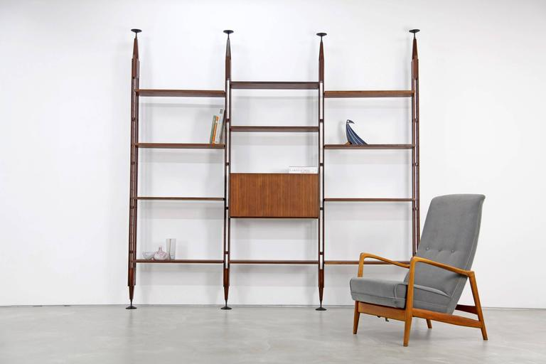Early edition bookcase by Franco Albini featuring 11 shelves and a cabinet. The shelf can be used as a room divider.