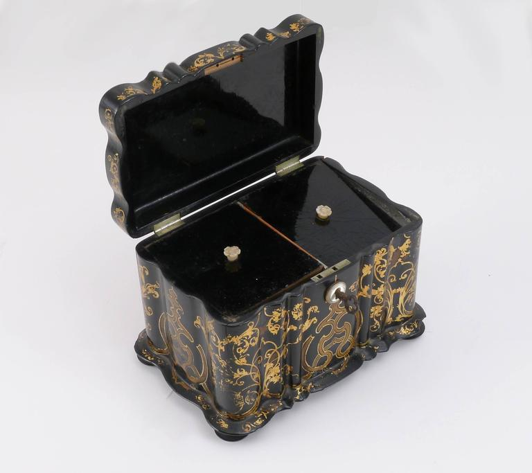 1850s lacquered tea caddy with key.  Architect, Sandy Littman of Duesenberg LTD.  and The American Glass Light Company have been making beautiful objects and collecting gorgeous antiques for nearly 40 years.