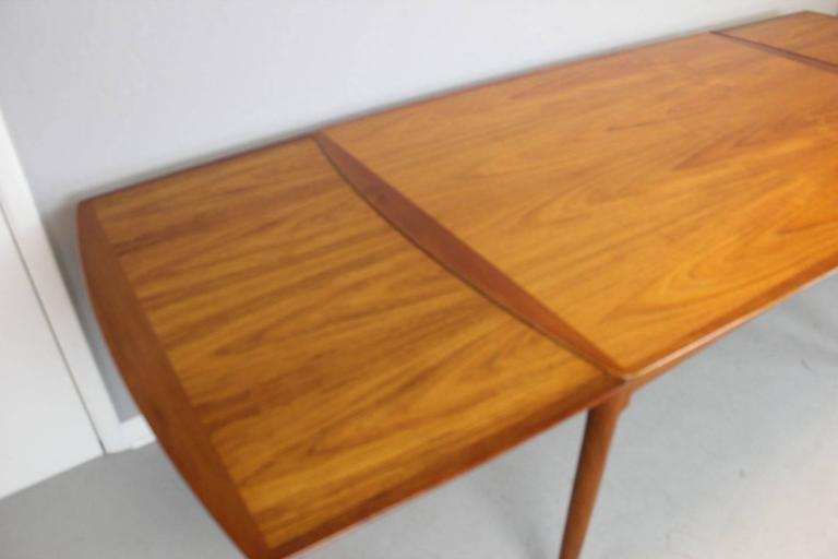 Danish Rare Hans Wegner Teak Dining Table With Two Built In Undermount Extension Leaves For