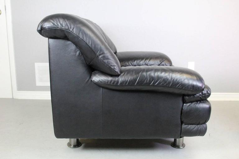 This matte black leather chair and ottoman with chrome pipe style legs is by Natuzzi Salotti & Natuzzi Salotti Leather Chair and Ottoman at 1stdibs