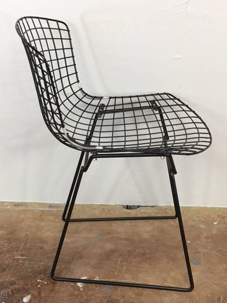 Black wire side chair by Harry Bertoia for Knoll, circa 1960s. This chair was very well maintained and remained covered in upholstery throughout its life. As such, it is in exceptional condition.