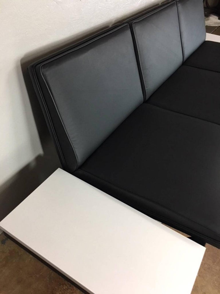 George Nelson steel frame sofa with new black leather and two white formica side tables. Seat height is 16 inches.