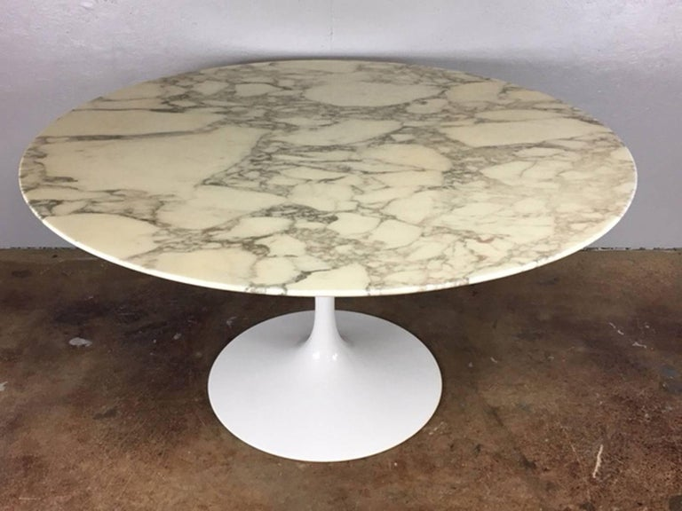54 inch diameter Eero Saarinen tulip base marble-top dining table for Knoll. Exceptional original condition. The wool rug (made in Germany) is also available for $950.