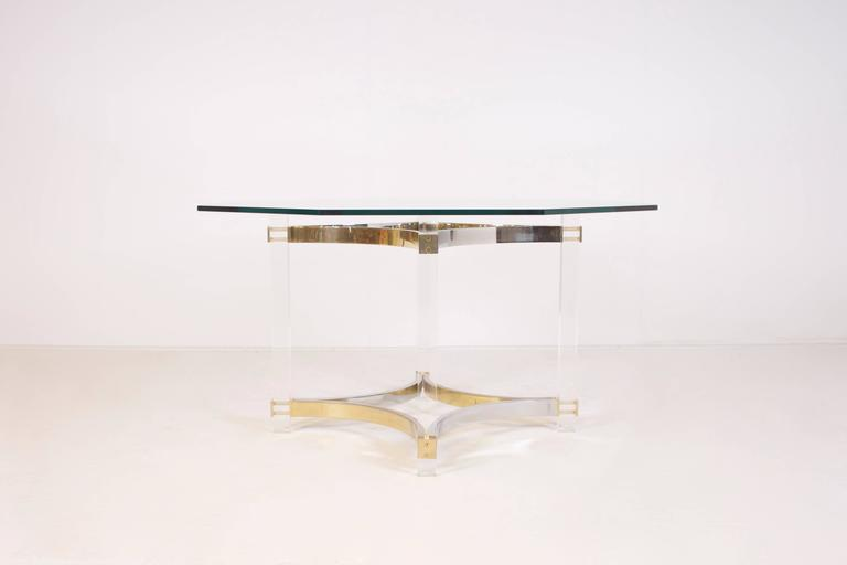 Stunning dining table by Alessandro Albrizzi.  Octagon shaped glass top.  Lucite supports connected with chrome and brass elements.  From now on all large and fragile overseas transports from Cadmium will be handled by the Tramo Group.  Tramo is the