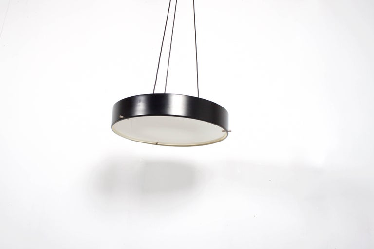 Rare Stilnovo Gatta 1090 Pendant in very good original condition.  Design: Bruno Gatta  Marked: Stilnovo   Black lacquered aluminum shade which holds a large opaline diffuser by three nickel pens.  The lamp hangs on three electrical wires which are